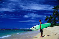 Teenager with surfboard at beach