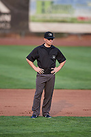 Umpire Bobby Tassone handles the calls on the bases during a game between the Ogden Raptors and the Billings Mustangs at Lindquist Field on August 18, 2018 in Ogden, Utah. Billings defeated Ogden 6-4. (Stephen Smith/Four Seam Images)