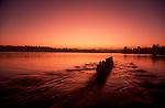 Women's eight-oared racing shell rowing at dawn, Seattle, Lake Washington,