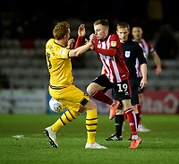Lincoln City's Joe Morrell vies for possession with Milton Keynes Dons' Dean Lewington<br /> <br /> Photographer Chris Vaughan/CameraSport<br /> <br /> The EFL Sky Bet League One - Lincoln City v Milton Keynes Dons - Tuesday 11th February 2020 - LNER Stadium - Lincoln<br /> <br /> World Copyright © 2020 CameraSport. All rights reserved. 43 Linden Ave. Countesthorpe. Leicester. England. LE8 5PG - Tel: +44 (0) 116 277 4147 - admin@camerasport.com - www.camerasport.com