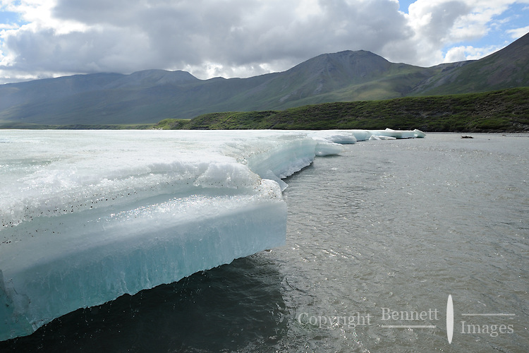 River ice known as aufeis melts in the summer warmth along the Hulahula River in Alaska's Arctic National Wildlife Refuge.