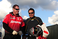 Feb. 26, 2011; Pomona, CA, USA; NHRA funny car driver Cruz Pedregon (right) with a crew member during qualifying at the Winternationals at Auto Club Raceway at Pomona. Mandatory Credit: Mark J. Rebilas-.