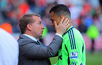 FAO SPORTS PICTURE DESK<br /> Pictured L-R: Swansea manager Brendan Rodgers thanks his goalkeeper Michel Vorm at the end of the game. Sunday, 13 May 2012<br /> Re: Premier League football, Swansea City FC v Liverpool FC at the Liberty Stadium, south Wales.