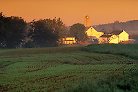 Farm buildings and field at sunrise. Strasburg Pennsylvania USA Lancaster County.