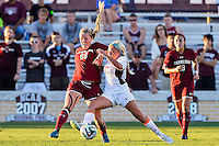 Texas A&M midfielder Mikaela Harvey (77) and South Carolina defender Paige Bendell (88) go after the ball during NCAA soccer game, Sunday, October 26, 2014 in College Station, Tex. South Carolina draw 2-2 against Texas A&M in double overtime. (Mo Khursheed/TFV Media via AP Images)