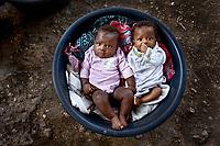 Babies sleeping in a Bucket After the Earthquake, Port-au-Prince, Haiti 2010.