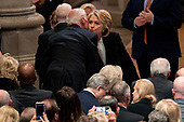 Former Secretary of State Hilary Clinton, right, greets former Vice President Joe Biden, left, before a State Funeral for former President George H.W. Bush at the National Cathedral, Wednesday, Dec. 5, 2018, in Washington. <br /> Credit: Andrew Harnik / Pool via CNP