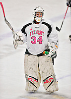 29 January 2012: University of Vermont Catamount goaltender Roxanne Douville, a Sophomore from Beloeil, Quebec, salutes the crowd after a game against the University of New Hampshire Wildcats at Gutterson Fieldhouse in Burlington, Vermont. Douville, dressed in the teams' Breast Cancer Awareness jersey, made 19 saves for Vermont earning her third win of the season as the Lady Cats edged out the Wildcats 2-1 to split their Hockey East twin-game weekend series. Mandatory Credit: Ed Wolfstein Photo