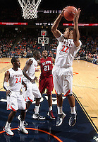 CHARLOTTESVILLE, VA- NOVEMBER 13: Malcolm Brogdon #22 of the Virginia Cavaliers grabs a rebound in front of Dante Wooten #21 of the South Carolina State Bulldogs during the game on November 13, 2011 at the John Paul Jones Arena in Charlottesville, Virginia. Virginia defeated South Carolina State 75-38. (Photo by Andrew Shurtleff/Getty Images) *** Local Caption *** Dante Wooten;Malcolm Brogdon