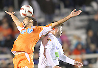 Marques Davidson #18 Of the Carolina Railhawks clashes with Joshua Hansen #20 of the Puerto Rico Islanders during the second leg of the USSF-D2 championship match at WakeMed Soccer Park, in Cary, North Carolina on October 30 2010. The game ended 1-1, Puerto Rico won on overall goals 3-1.