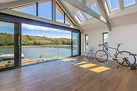 BNPS.co.uk (01202 558833)<br /> Pic: Savills/BNPS<br /> <br /> Pictured: A large open lounge space with panoramic views over Mill Pond.<br /> <br /> A former tidal mill next to an impressive viaduct that looks like the perfect backdrop for a children's book is on the market for £3.5m.<br /> <br /> The Old Mill is over 600 years old and would be an ideal home for Swallows and Amazons or The Railway Children-inspired adventures.<br /> <br /> The impressive Grade II listed six-bedroom house has its own private harbour and panoramic views of the much-photographed Forder Railway Viaduct.<br /> <br /> It is only the second time the property in Cornwall has been on the market since 1886 and agents Savills say it is a once in a lifetime opportunity.
