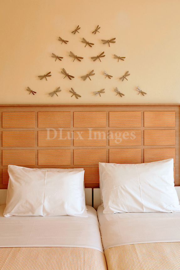 Twin beds with wall decor