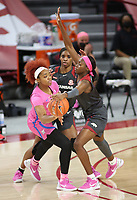 Marquesha Davis, with the University of Arkansas Razorback Women's basketball team, defends against Sarah Dumitrescu with the University of University of Mississippi Friday, February 19, 2021, at Bud Walton Arena on the campus of the University in Fayetteville. Check out nwaonline.com/210220Daily/ and nwadg.com/photos for a photo gallery.<br /> (NWA Democrat-Gazette/David Gottschalk)