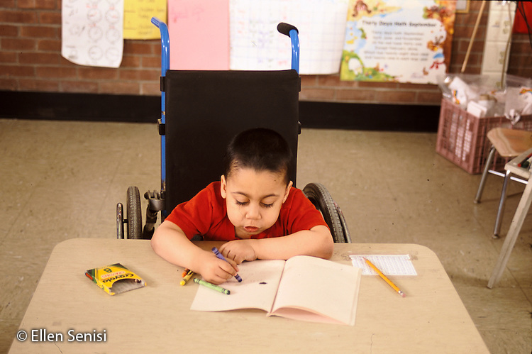 MR / Schenectady, NY.Zoller Public School - Grade 1 Inclusion Class - .Student in wheelchair works independently on in-class language arts assignment  (Boy: 7, Bangledeshi and Puerto-Rican-American, spina bifida, sacral agenesis).MR:  Rah1.PN#: 28426                   FC#: 21675-00111.scan from slide.© Ellen B. Senisi