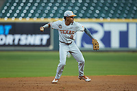 Texas Longhorns shortstop Trey Faltine (0) makes a throw to first base against the LSU Tigers in game three of the 2020 Shriners Hospitals for Children College Classic at Minute Maid Park on February 28, 2020 in Houston, Texas. The Tigers defeated the Longhorns 4-3. (Brian Westerholt/Four Seam Images)