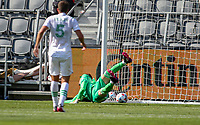 LOS ANGELES, CA - APRIL 17: Brad Stuver #41 of Austin FC just misses a ball during a game between Austin FC and Los Angeles FC at Banc of California Stadium on April 17, 2021 in Los Angeles, California.
