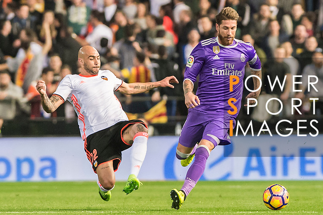 Sergio Ramos (r) of Real Madrid battles for the ball with Simone Zaza of Valencia CF during their La Liga match between Valencia CF and Real Madrid at the Estadio de Mestalla on 22 February 2017 in Valencia, Spain. Photo by Maria Jose Segovia Carmona / Power Sport Images