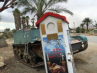 "10. ""Charity for the Orphans and Widows"": alms box with abandoned tank outside cafe, Jordan Valley.<br />