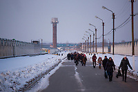 Workers leave for the day at the Alekseevskii state farm outside Ufa, Bashkortostan, Russia.  The farm employees about 1,500 people.