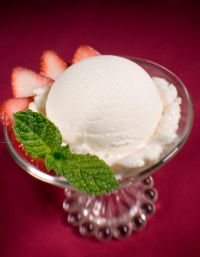 Vanilla Icecream with Strawberries on red backdrop