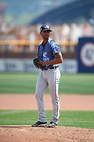 West Michigan Whitecaps relief pitcher Johan Belisario (9) gets ready to deliver a pitch during a game against the Quad Cities River Bandits on July 23, 2018 at Modern Woodmen Park in Davenport, Iowa.  Quad Cities defeated West Michigan 7-4.  (Mike Janes/Four Seam Images)