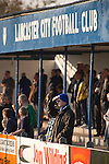Lancaster City 0 FC Halifax Town 3, 15/10/2011, Giant Axe, FA Cup Third Qualifying Round. Home team supporters watching the action from the terraces behind the goal during the second half as Lancaster City (in blue) play against FC Halifax Town in an FA Cup third qualifying round match at Giant Axe stadium. The visitors, who play two leagues above their hosts in the English football pyramid, won the ties by three goals to nil, watched by a crowd of 646 spectators. Lancaster City were celebrating their centenary in 2011, although there was a dispute over the exact founding date over the club known as Dolly Blue. Photo by Colin McPherson.