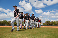 Ball State Cardinals Nick Powell (9), Chandler Hughes (14), Nolan Gazouski (10), Justin Conant (15), and Landon McGill (43) high five teammates after a game against the Saint Joseph's Hawks on March 9, 2019 at North Charlotte Regional Park in Port Charlotte, Florida.  Ball State defeated Saint Joseph's 7-5.  (Mike Janes/Four Seam Images)
