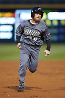 Tommy Bullock (9) of the Charlotte 49ers hustles towards third base against the Wake Forest Demon Deacons at BB&T BallPark on March 13, 2018 in Charlotte, North Carolina.  The 49ers defeated the Demon Deacons 13-1.  (Brian Westerholt/Four Seam Images)