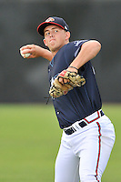 Pitcher Devan Watts (40) of the Danville Braves warms up before in a game against the Johnson City Cardinals on Friday, July 1, 2016, at Legion Field at Dan Daniel Memorial Park in Danville, Virginia. Johnson City won, 1-0. (Tom Priddy/Four Seam Images)