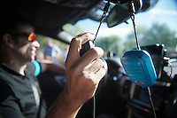 Team SKY DS Dario Cioni has 2 radio's in the teamcar: black for the other DS/teamcar & (Team SKY-) blue for the riders <br /> <br /> stage 21: Alcala de Henares - Madrid (98km)<br /> 2015 Vuelta à Espana