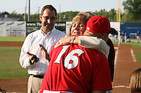 June 19, 2009:  Naomi Silver hugs Manager Mark DeJohn after presenting him with his championship ring as Cardinals General Manager John Mozeliak looks on during a ceremony to award the 2008 NY-Penn League Champions before a game at Dwyer Stadium in Batavia, NY.  The Batavia Muckdogs are the NY-Penn League Short Season Class-A affiliate of the St. Louis Cardinals.  Photo by:  Mike Janes/Four Seam Images