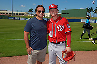 Washington Nationals Jake Randa (24) poses for a photo with his father, former Major Leaguer Joe Randa, after an Instructional League game against the Miami Marlins on September 26, 2019 at FITTEAM Ballpark of The Palm Beaches in Palm Beach, Florida.  (Mike Janes/Four Seam Images)