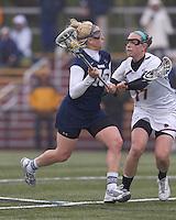 University of New Hampshire midfielder Rachael Nock (16) on the attack as Boston College midfielder Mikaela Rix (17) defends. Boston College defeated University of New Hampshire, 11-6, at Newton Campus Field, May 1, 2012.