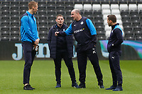 Paul Cook, manager for Wigan Athletic (3rd L) speaks to colleagues prior to the Sky Bet Championship match between Swansea City and Wigan Athletic at the Liberty Stadium, Swansea, Wales, UK. Saturday 29 December 2018