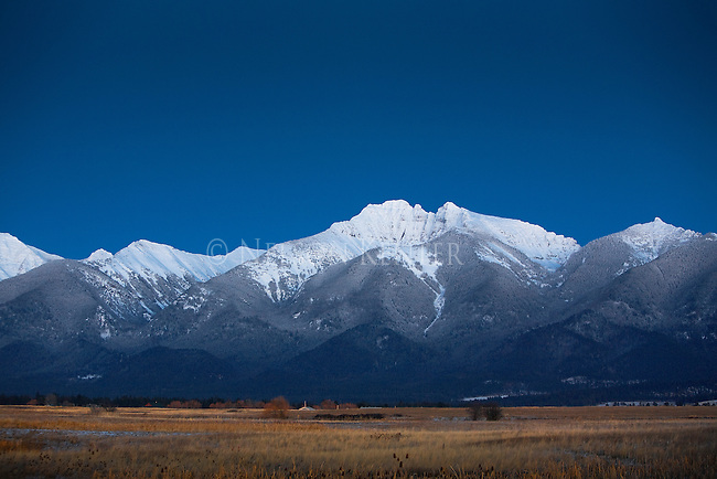 The snowcapped peaks of the Mission Mountains in Montana after the sun set