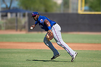 Texas Rangers first baseman Tyreque Reed (98) prepares to make a throw to first base during an Instructional League game against the San Diego Padres on September 20, 2017 at Peoria Sports Complex in Peoria, Arizona. (Zachary Lucy/Four Seam Images)