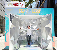 """SANTA MONICA, CA - JUNE 11: George Sear poses for a photo at a special photo-activation in honor of Pride Month and the Season 2 premiere of the Hulu Original Series """"Love, Victor,"""" on June 11, 2021 in Santa Monica, California. (Photo by Frank Micelotta/Hulu/PictureGroup)"""