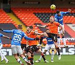 13.12.2020 Dundee Utd v Rangers: Leon Balogun rises above Mark Connolly