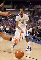 Scott Suggs passes the ball under the hands and feet of Joe Burton. The Washington Huskies defeated the Oregon State Beavers 59-52 during the Pac-10 Tournament at the Staples Center in Los Angeles, California on March 11th, 2010.