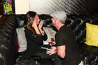 Guy proposing to his very emotional girlfriend at The W Union Square hotel lounge.