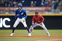 Lewin Diaz (11) of the Jacksonville Jumbo Shrimp on defense as Dalton Kelly (19) of the Durham Bulls takes his lead off of first base at Durham Bulls Athletic Park on May 15, 2021 in Durham, North Carolina. (Brian Westerholt/Four Seam Images)