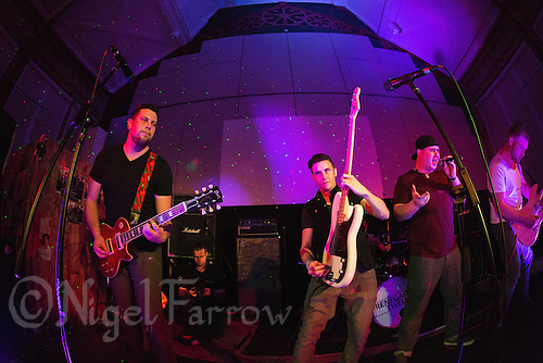 10 Jan 2015 - STOWMARKET, GBR - Renegade Twelve perform at the John Peel Centre for Creative Arts in Stowmarket, Suffolk, Great Britain. From the left Dan Potter (lead guitar), Josh Barnard (bass guitar),  Sam Robson (vocals) and Jake Mayes, (lead guitar) (PHOTO COPYRIGHT © 2015 NIGEL FARROW, ALL RIGHTS RESERVED)