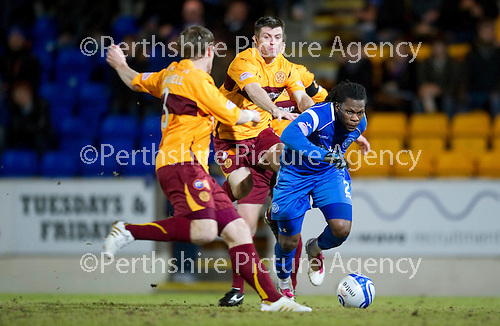 St Johnstone v Motherwell....26.01.11  .Collin Samuel fouled by Steven Jernnings.Picture by Graeme Hart..Copyright Perthshire Picture Agency.Tel: 01738 623350  Mobile: 07990 594431