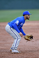 Third baseman Alex Rodriguez (19) of the Kentucky Wildcats plays defense in a game in the rain against the University of South Carolina Upstate Spartans on Saturday, February 17, 2018, at Cleveland S. Harley Park in Spartanburg, South Carolina. Kentucky won, 6-5, in 10 innings. (Tom Priddy/Four Seam Images)