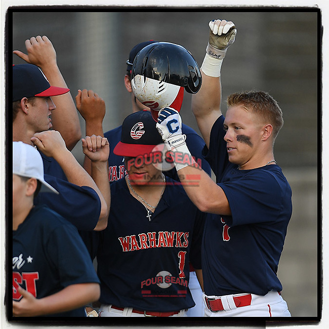 Greenville High grad Clay Wilson (7) of the Greer Warhawks, now on The Citadel roster, is greeted after hitting a home run in a South Carolina American League playoff game against Easley on Tuesday, August 4, 2020, at Stevens Field in Greer, South Carolina. Greer won, 9-6. (Tom Priddy/Four Seam Images)