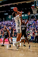 18 December 2019: University of North Carolina Greensboro Spartan Forward James Dickey, a Senior from Raleigh, NC, defends his basket in second half action against the University of Vermont Catamounts at Patrick Gymnasium in Burlington, Vermont. The Spartans edged out the Catamounts 54-53 in the final minutes of play. Mandatory Credit: Ed Wolfstein Photo *** RAW (NEF) Image File Available ***