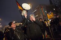 """Etwa 200 Anhaenger des Berliner Ablegers rechten Pegida-Bewegung, Baergida, versammelten sich am Montag den 5. Januar 2015 in Berlin zu einer Demonstration gegen eine angebliche Islamisierung Deutschlands und dagegen, dass """"in 30 Jahren in Deutschland die Sharia herrscht"""", so der Organisator Karl Schmitt.Bis zu 5.000 Menschen protestierten gegen den rechten Ausmarsch und blockierten bei Regen die Marschroute mehrere Stunden. Die Polizei schaffte es nicht mit koerperlicher Gewalt die Blockade zu beenden, so dass die Rechten nach drei Stunden nach Hause gehen mussten. Die Baergida-Anhaenger, """"Berlin gegen die Islamisierung des Abendlandes"""", feierten dies aber dennoch als Sieg. Waren zur ersten Baergida-Aktion eine Woche zuvor nur 5 Menschen gekommen.<br /> Unter den Anhaengern von Baergida waren viele bekannte militante Neonazis und Hooligans sowie Mitglieder der Rechtsparteien AfD und Pro Deutschland und der rechtsradikalen German Defense League. Immer wieder wurde skandiert """"Luegenpresse, auf die Fresse"""" und dass die Journalisten nach Israel verschwinden sollen.<br /> Im Bild: Der Veranstaltungsorganisator Karl Schmitt, ehem. CDU-Mitglied und Verfasser Verschwoerungstheoretischer Schriften, spricht zu den Baergida-Anhaengern.<br /> 5.1.2015, Berlin<br /> Copyright: Christian-Ditsch.de<br /> [Inhaltsveraendernde Manipulation des Fotos nur nach ausdruecklicher Genehmigung des Fotografen. Vereinbarungen ueber Abtretung von Persoenlichkeitsrechten/Model Release der abgebildeten Person/Personen liegen nicht vor. NO MODEL RELEASE! Nur fuer Redaktionelle Zwecke. Don't publish without copyright Christian-Ditsch.de, Veroeffentlichung nur mit Fotografennennung, sowie gegen Honorar, MwSt. und Beleg. Konto: I N G - D i B a, IBAN DE58500105175400192269, BIC INGDDEFFXXX, Kontakt: post@christian-ditsch.de<br /> Bei der Bearbeitung der Dateiinformationen darf die Urheberkennzeichnung in den EXIF- und  IPTC-Daten nicht entfernt werden, diese sind in digitalen Medien nach §95c UrhG r"""