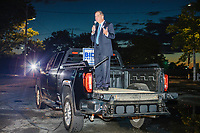 """Boston Mayor Marty Walsh spoke from the back of a pickup truck at the start of the event as people gathered to watch the 2020 Democratic National Convention at a """"Ridin' with Biden"""" Drive-In Theater viewing event at Suffolk Downs in Boston, Massachusetts, on Wed., Aug. 19, 2020."""