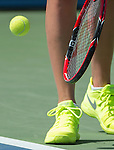 Petra Kvitova (CZE) chooses bright colors for shoes, dress, tennis balls at the US Open in Flushing, NY on September 9, 2015.