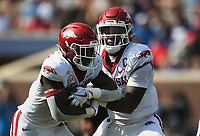 Arkansas quarterback KJ Jefferson (1) hands the ball of to running back Raheim Sanders (5), Saturday, October 9, 2021 during the second quarter of a football game at Vaught Hemingway Stadium in Oxford, Miss. Check out nwaonline.com/211010Daily/ for today's photo gallery. <br /> (NWA Democrat-Gazette/Charlie Kaijo)